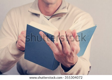 Man reading a book close up. Vintage image