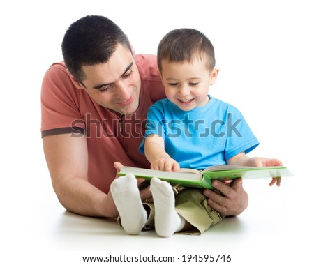 man reading a book to son - stock photo