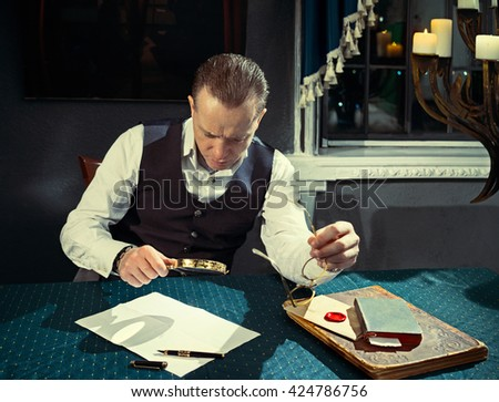 Man reading a letter with a magnifying glass