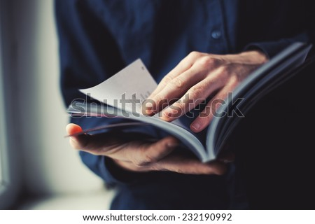 man reading a magazine - stock photo