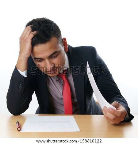 man reading contract at his desk - stock photo