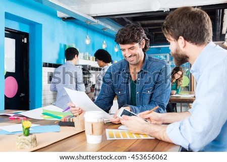 Man reading document business people colleagues working diverse mix race group casual wear modern office businesspeople sitting desk - stock photo
