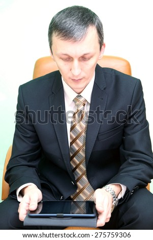 man reading from the pad - stock photo