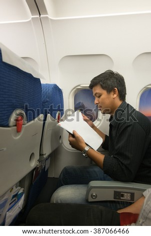 Man reading in airplane