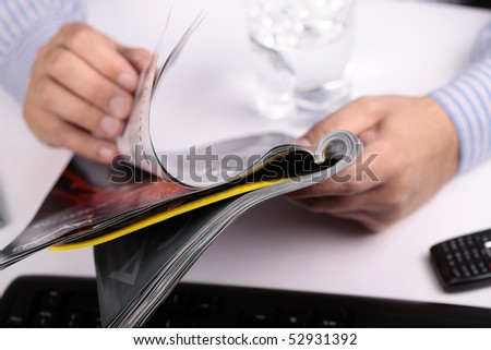 Man reading Magazine in Office - stock photo