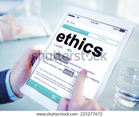 Man Reading the Definition of Ethics - stock photo