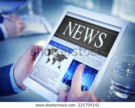 Man Reading the News on a Digital Tablet - stock photo