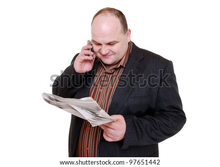 man reads newspaper and has a call - stock photo