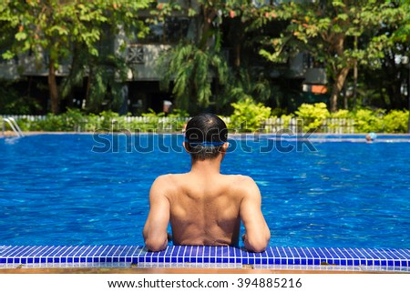 man ready to swimming in the swimming pool - stock photo