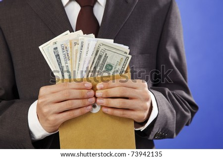 man received money in the envelope - stock photo