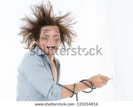 Man receiving an electric shock after a short circuit - stock photo