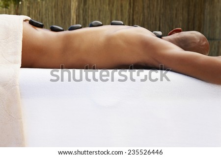 Man Receiving LaStone Therapy - stock photo
