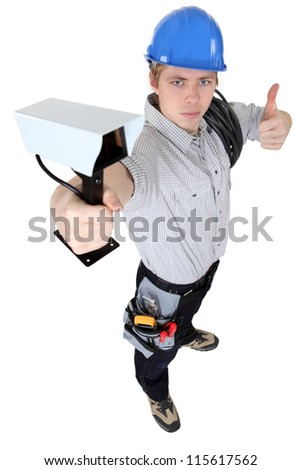 Man recommending a security camera - stock photo