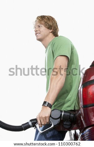 Man refueling a car - stock photo