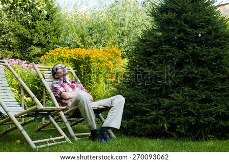 Man relax outdoor in his own garden at summer day - stock photo