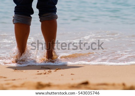 Man relax stand on beach as  vacation