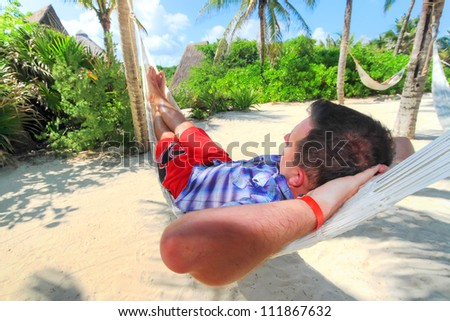 Man relaxing in a hammock, Mexico - stock photo