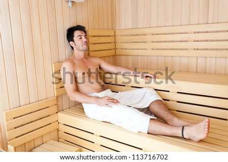 Man relaxing in a sauna - stock photo