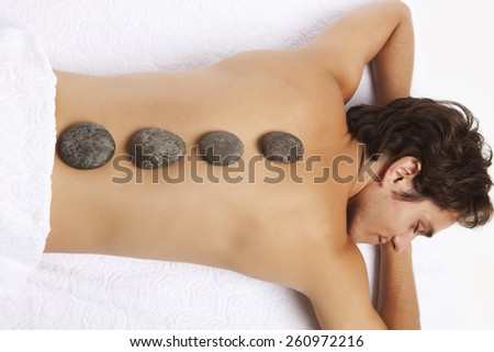 Man relaxing in spa - stock photo