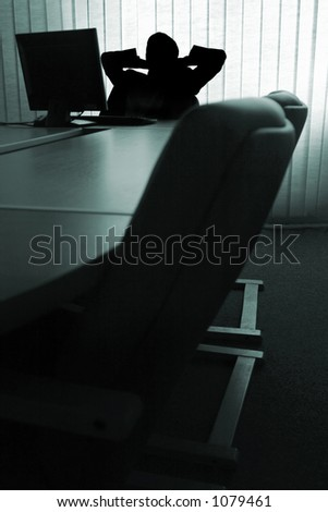 Man relaxing in the office - stock photo