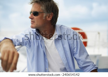 Man Relaxing on Boat - stock photo