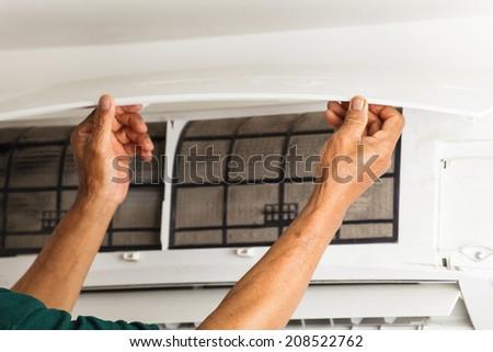 man repair air conditioner  - stock photo