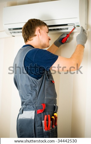 man repair air conditioner