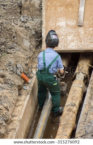 Man repairing heating pipes, above view