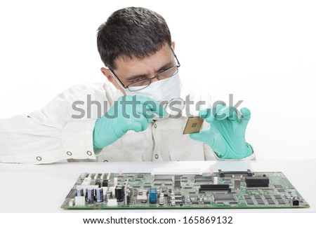 Man repairing microchip electronic equipment with mangnifying glass isolated on white background - stock photo