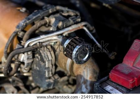 Man repairing motor block of a car - stock photo