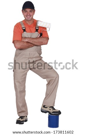 Man resting foot on pot - stock photo