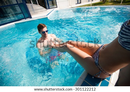 man resting in the pool in the summer - stock photo