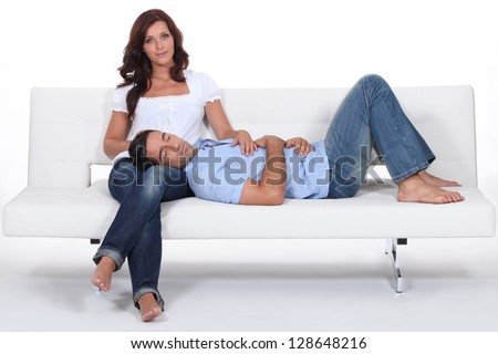 Man resting on his girlfriend lap. - stock photo
