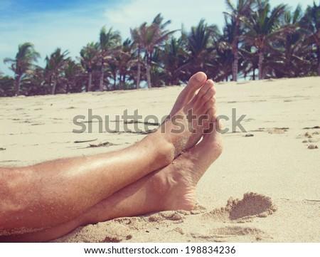 man resting on the beach - stock photo