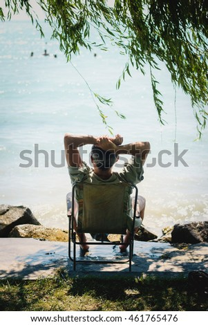 Man resting on the lake.
