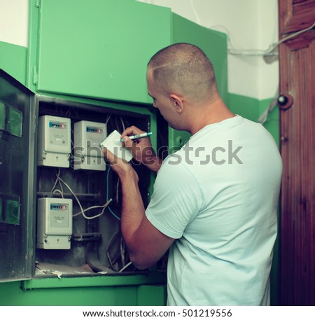 Man rewrites the electrical meter readings