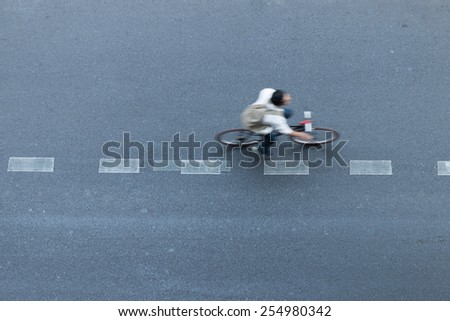 man ride bicycle in city - stock photo