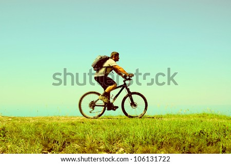 Man rides a bicycle - stock photo