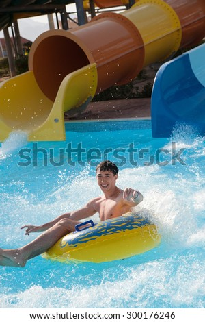 man rides in the water park