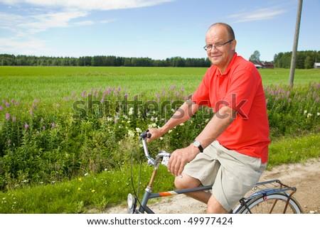 Man riding a bicycle - stock photo