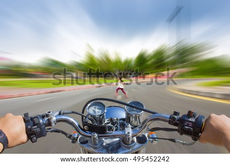 Man riding a motorcycle, blur image of motion accidents will happen on the road as background.