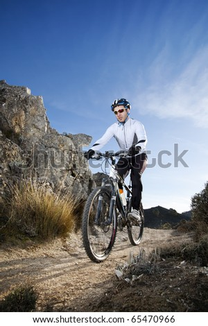 Man riding a mountainbike on a mountain track - stock photo