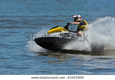 Man Riding Jet Ski Wet Bike Personal Watercraft - stock photo
