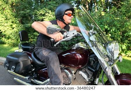 Man Riding Motorcycle - stock photo
