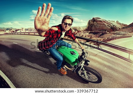 Man riding motorcycle in  highway. Top view - stock photo