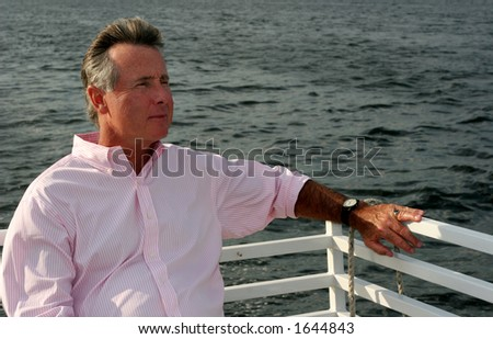 man riding on boat - stock photo