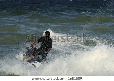 man riding skijet - stock photo