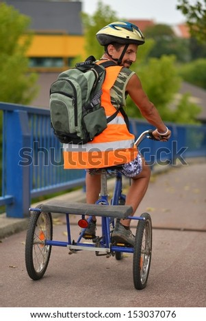 Man Riding Tricycle - stock photo