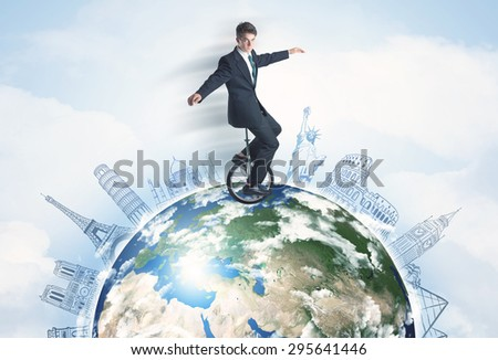 "Man riding unicycle around the globe with major cities concept,""""Elements of this image furnished by NASA"""" - stock photo"