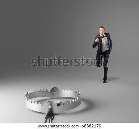 man run and 3d metal trap - stock photo